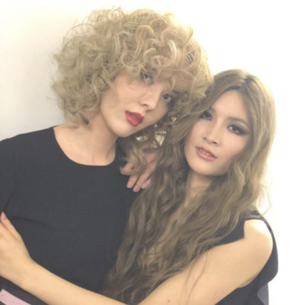 two blond asian woman one with curly hair and second with wavy hair. gemini sign